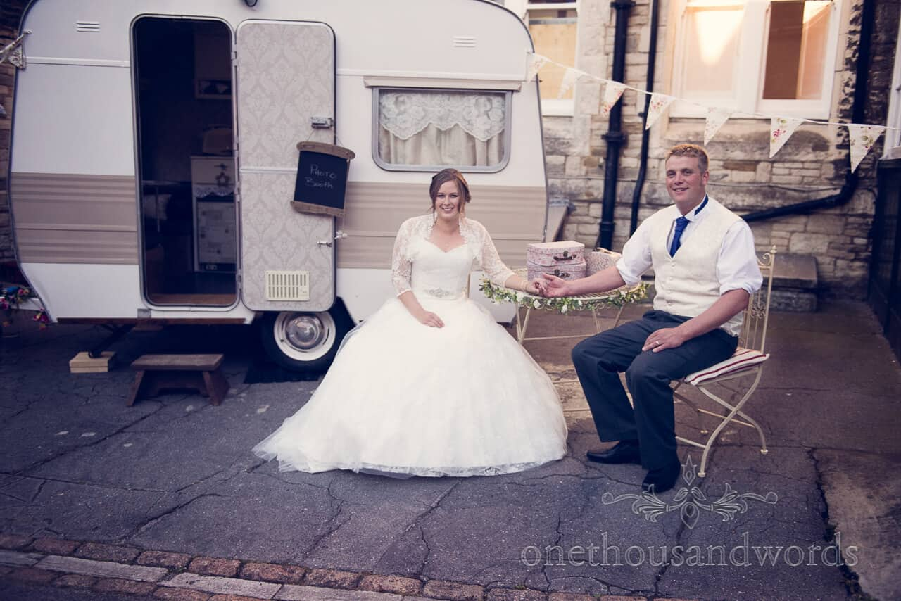 Bride and groom with photo booth caravan