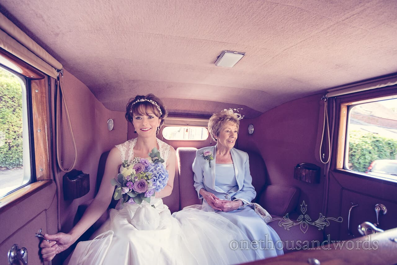 Bride and mother in wedding car at Lulworth Castle