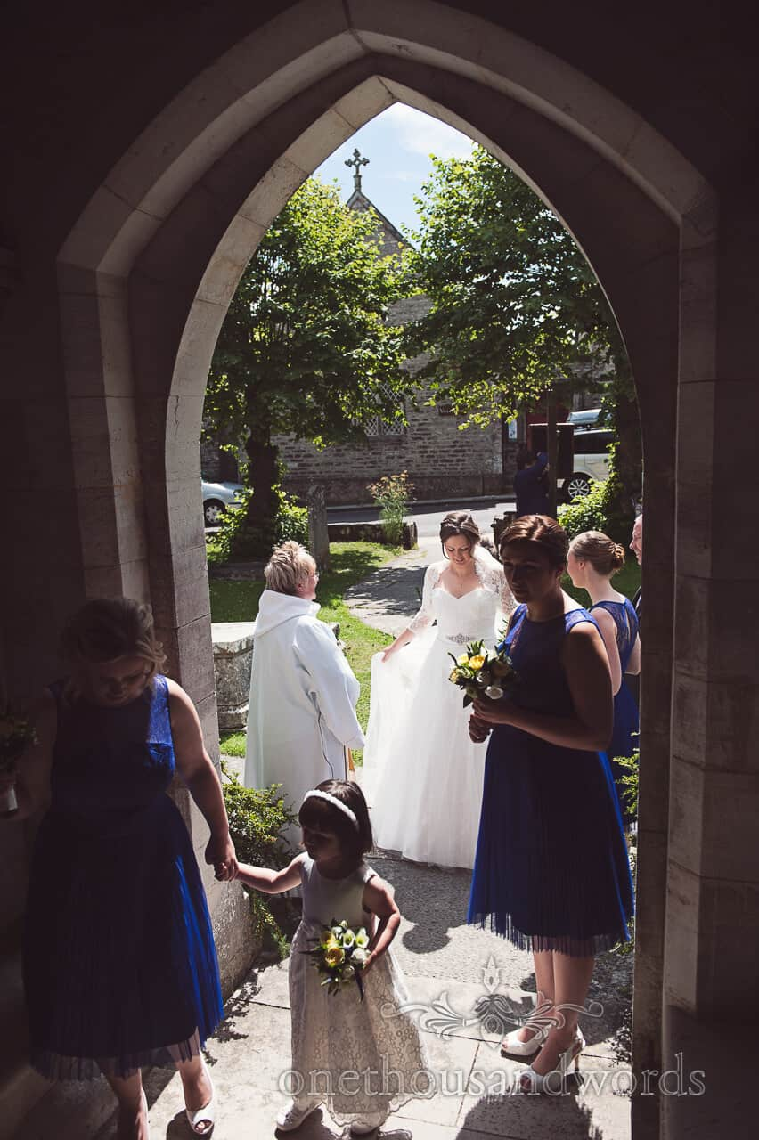 Bride arrives at her countryside wedding church