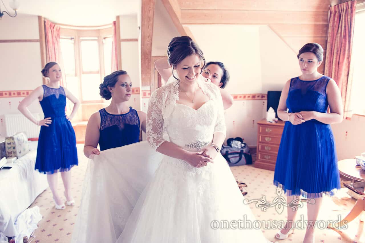 bride & bridesmaids in blue dresses on wedding morning