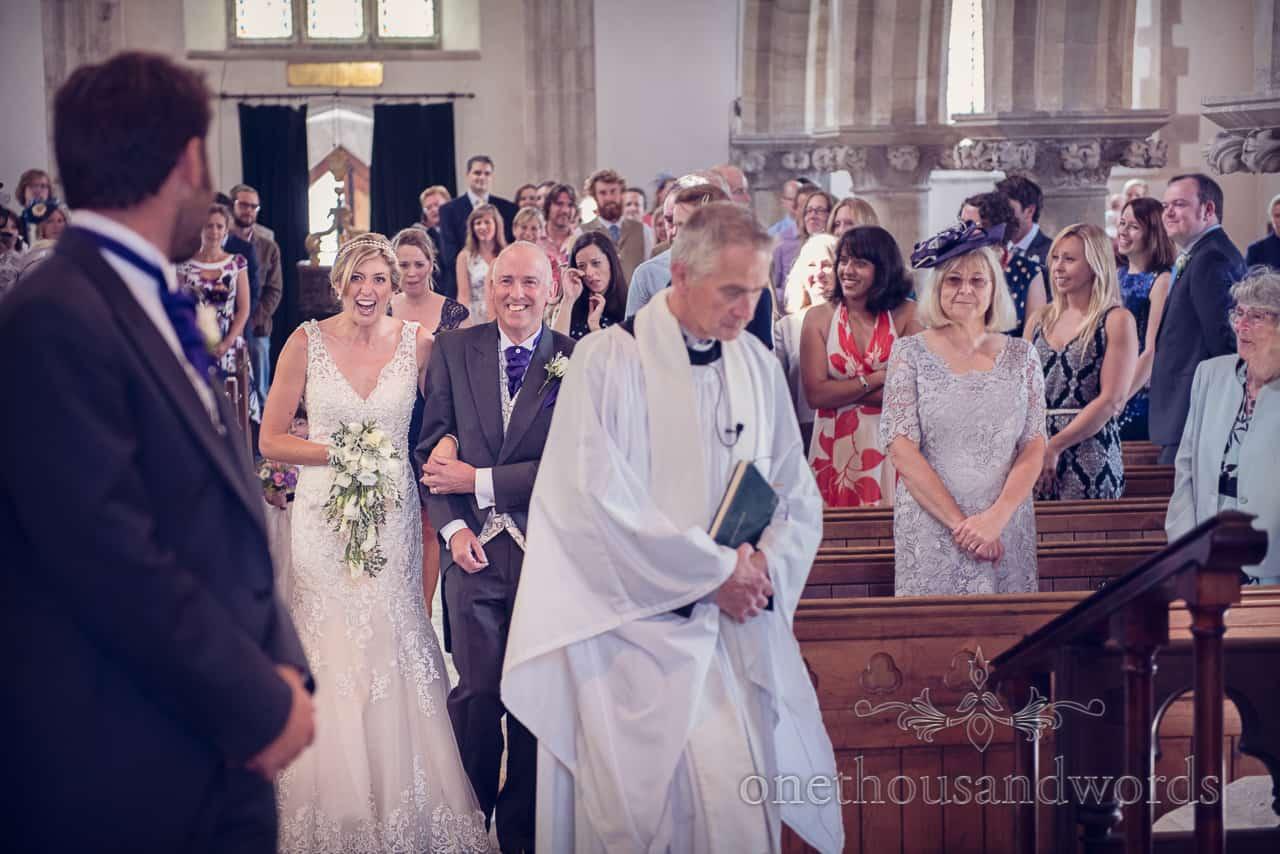 Bride Enters Corfe Church Wedding in Dorset
