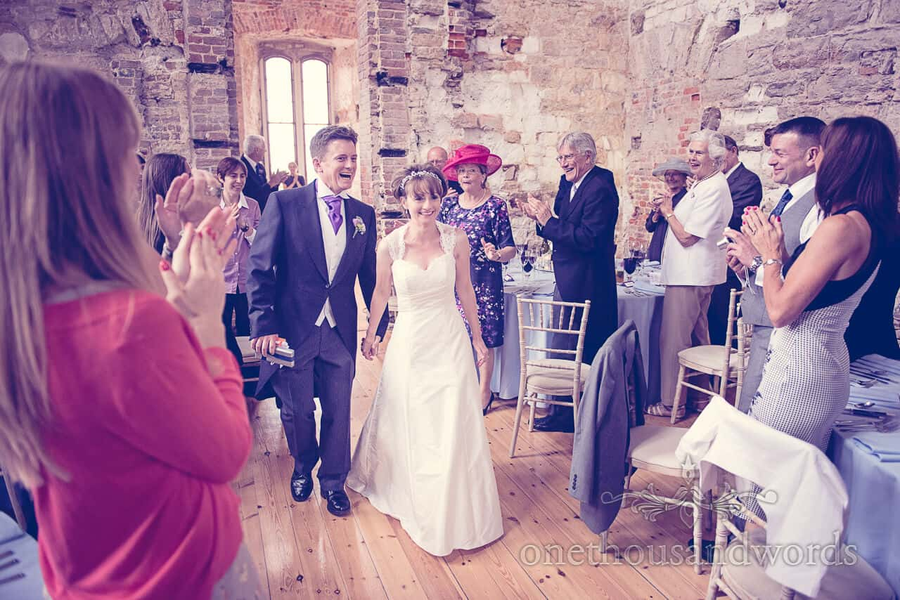 Bride & Groom enter Lulworth Castle wedding breakfast