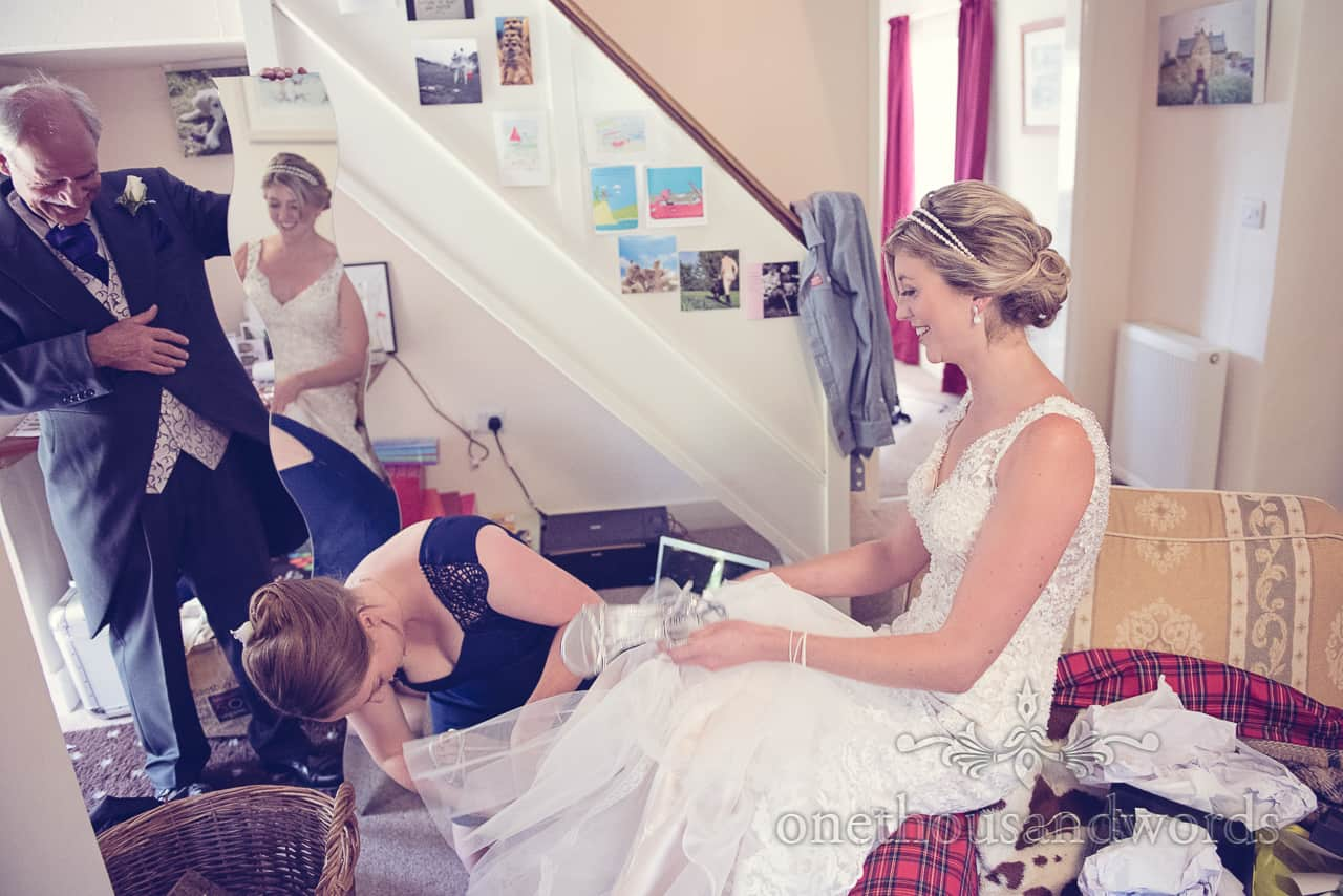 Bride in Mirror Puts on Wedding Shoes