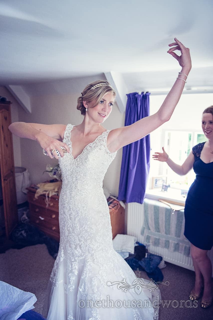 Bride in Wedding Dress Dances Putting on Perfume