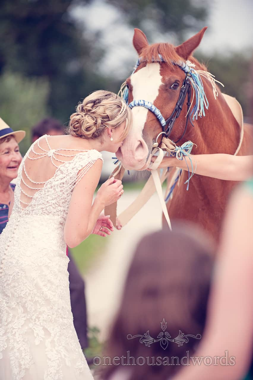 Bride Kisses her Horse at Countryside Wedding in Dorset