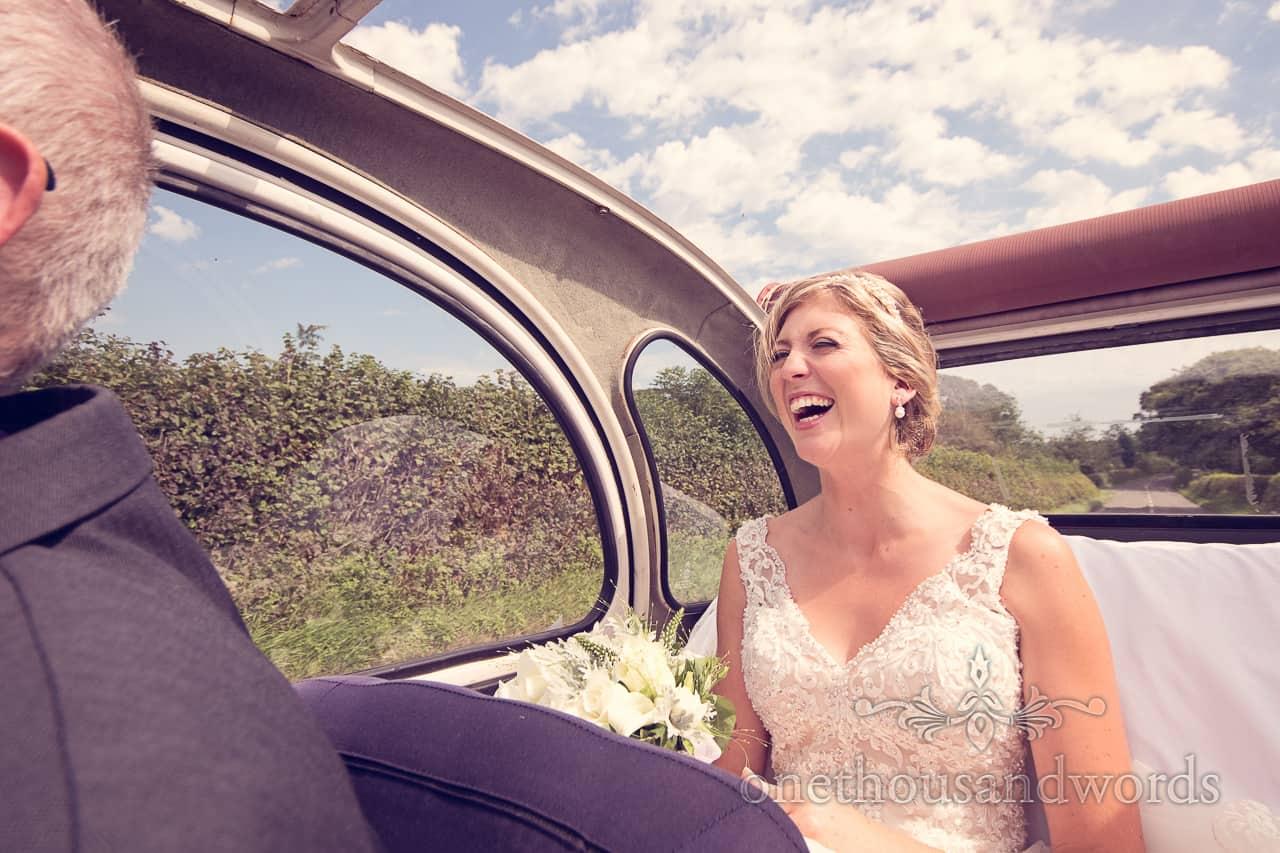 Bride Laughs in 2CV Wedding Car in Dorset Countryside