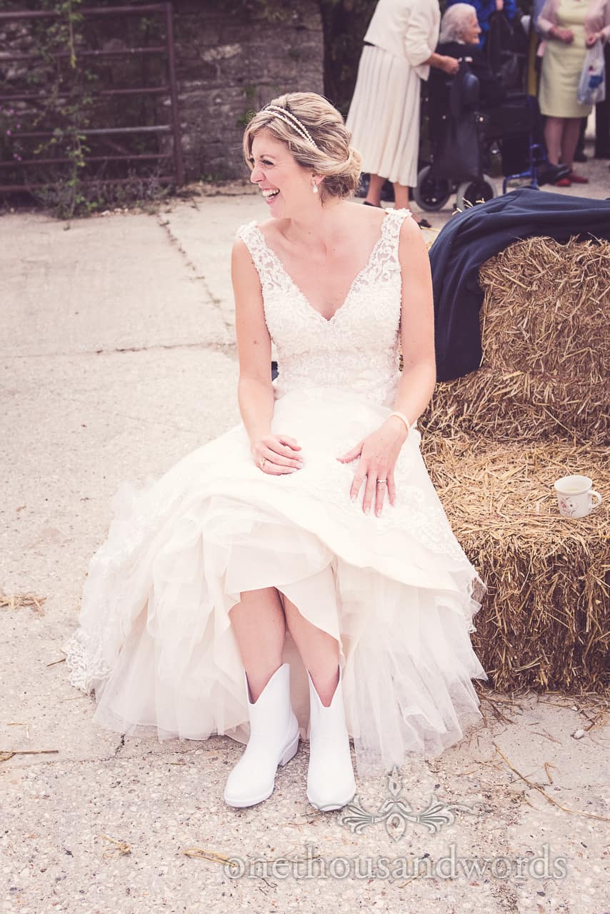 Bride Laughs in White Wedding Wellington Boots
