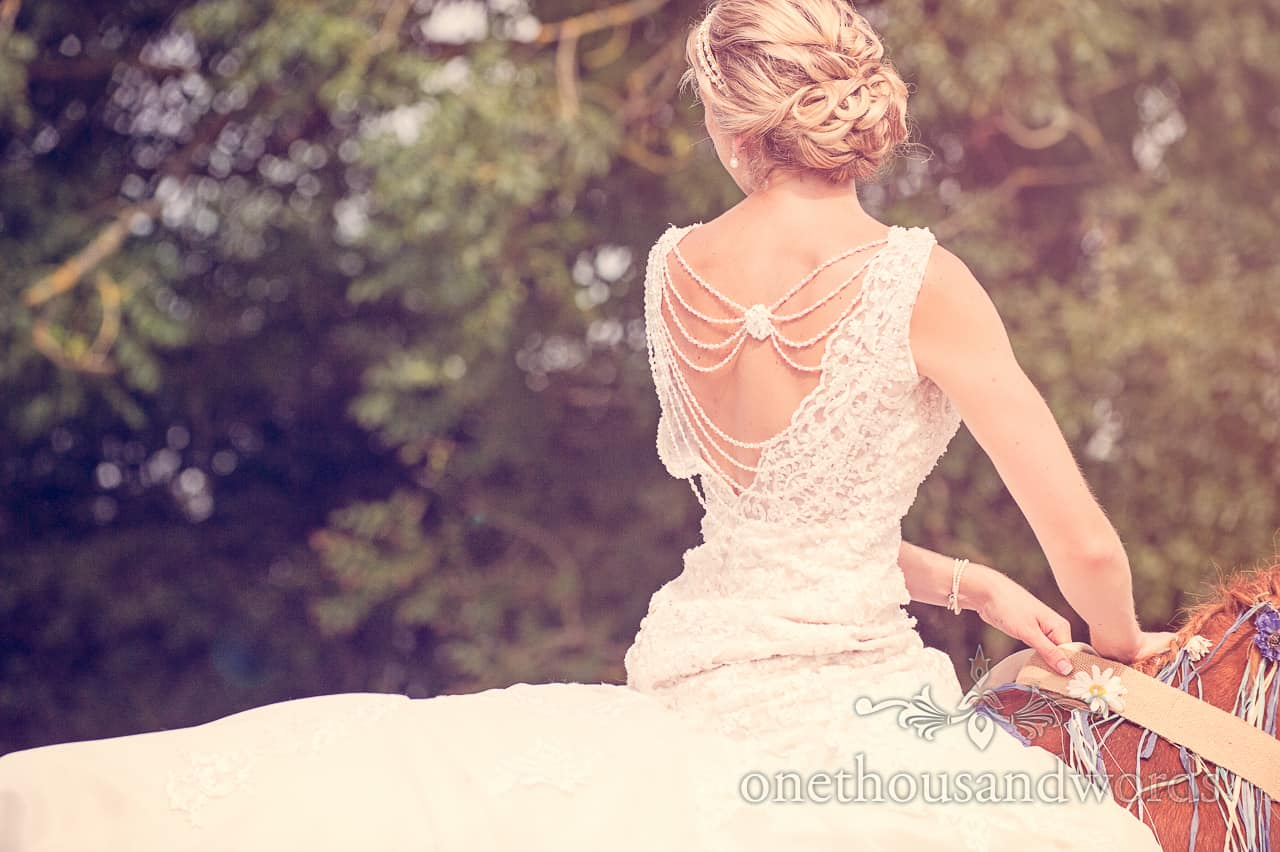 Bride on Horse in Backless V Wedding Dress