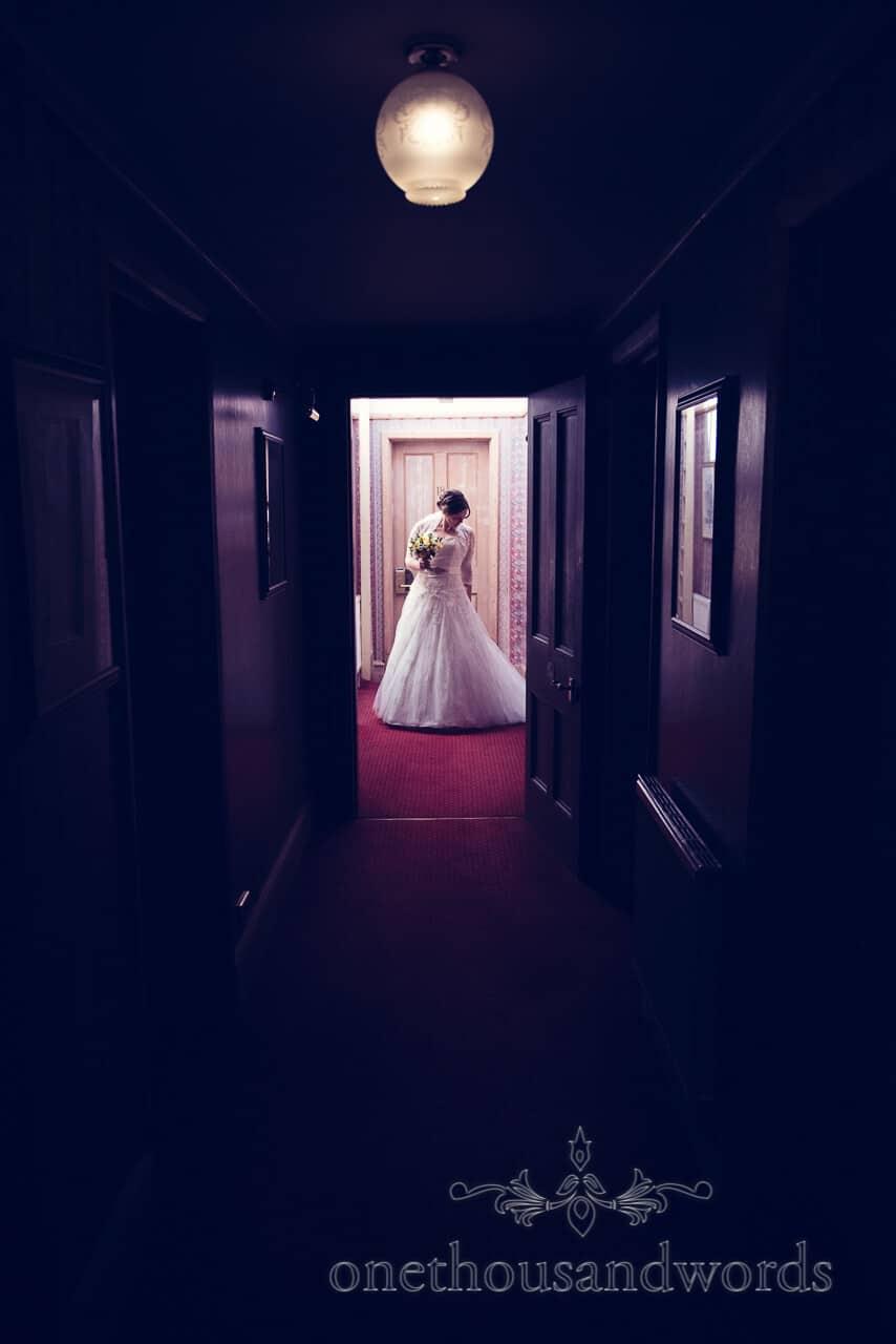 Bride portrait in dark corridor