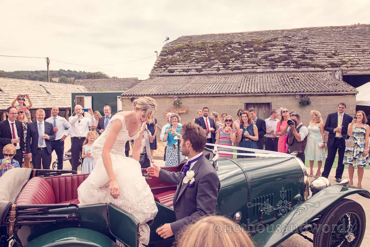 Bride Steps Out of Wedding Car at Barn Wedding