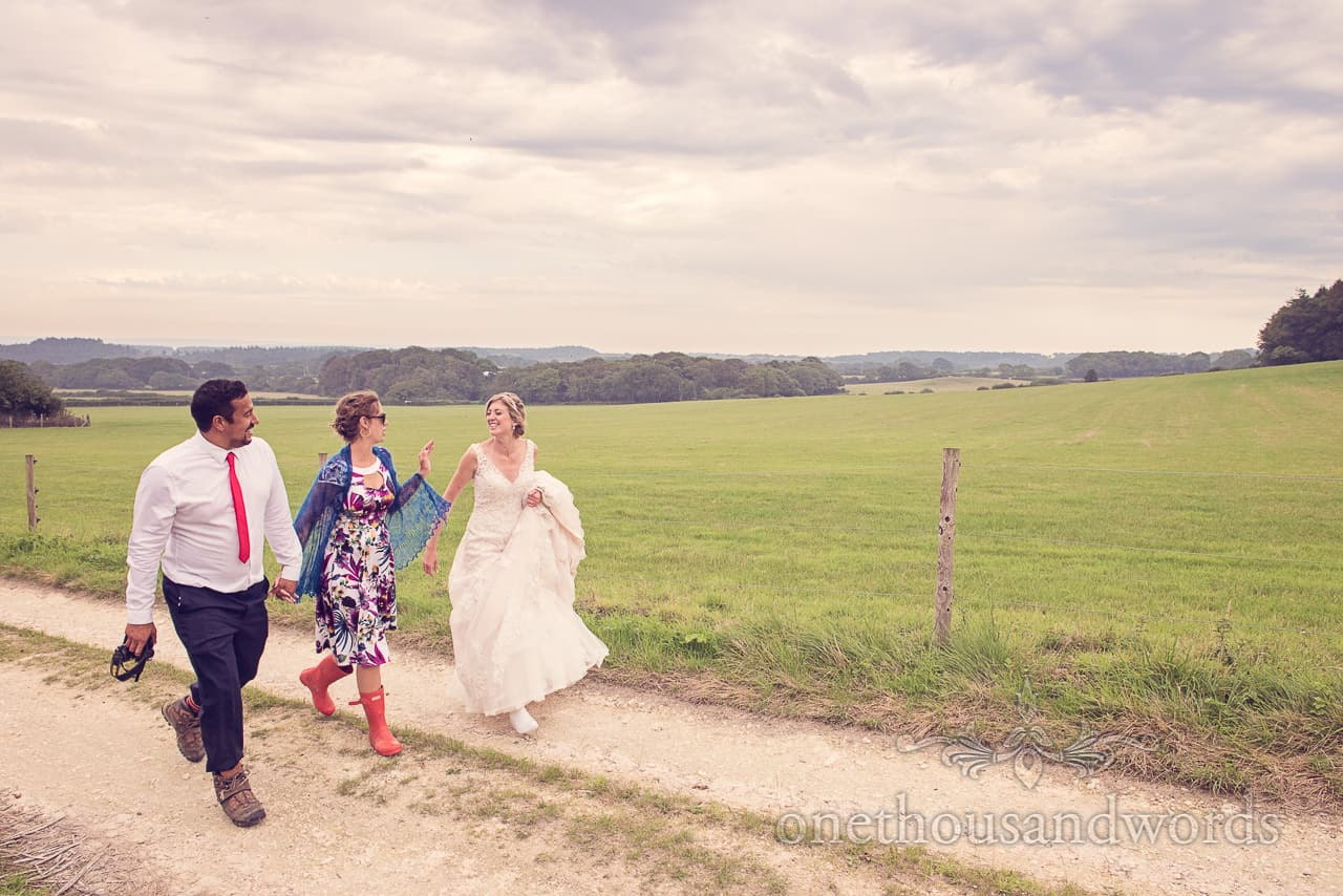 Bride walks in Countryside at Wedding in Dorset