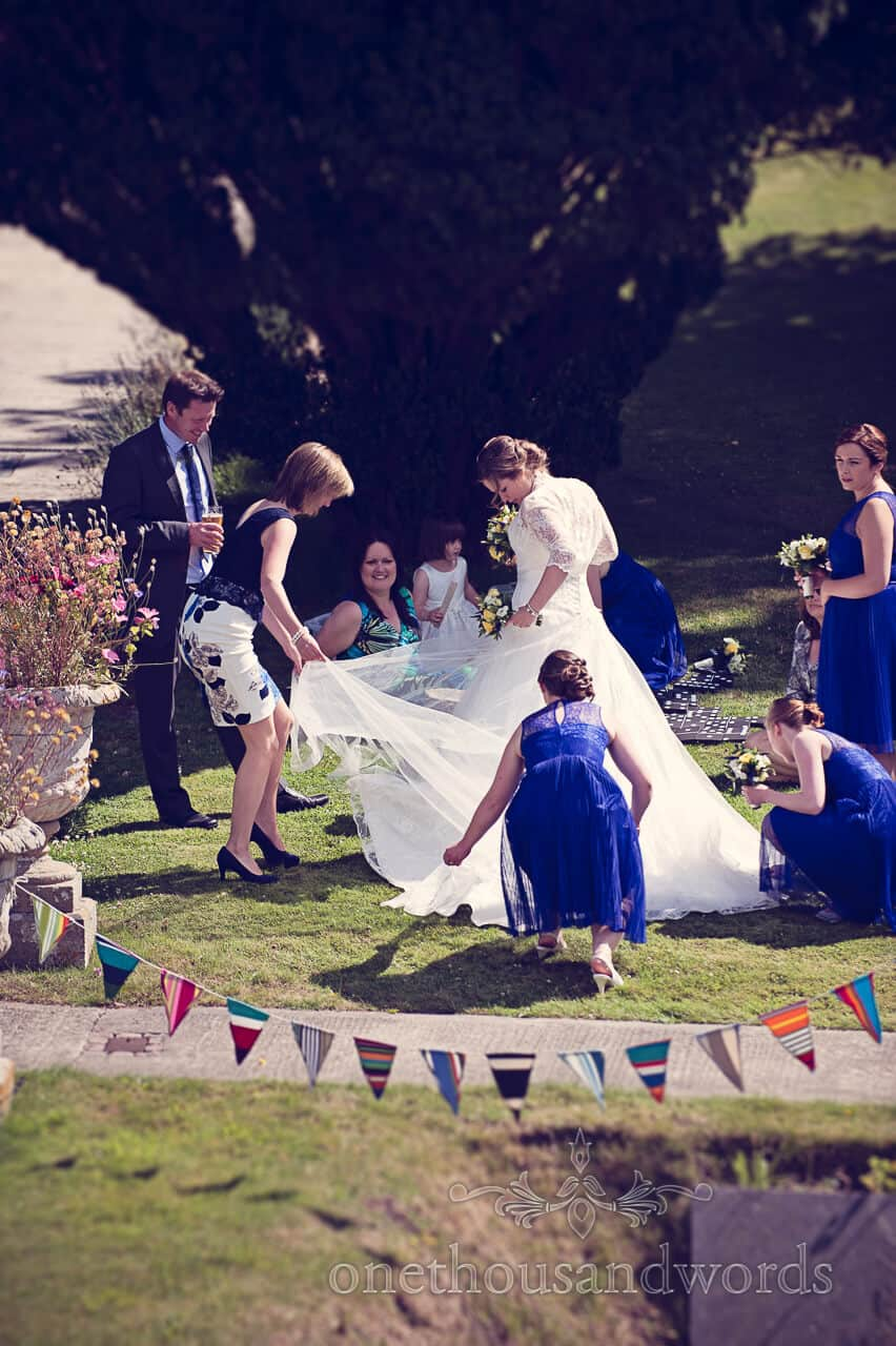 Bride's dress adjusted in Purbeck House Hotel gardens