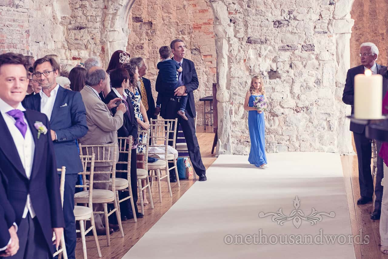 Bridesmaid in blue dress at Lulworth Castle wedding