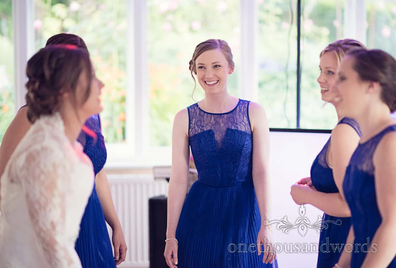 Bridesmaids in blue dancing at Purbeck House Hotel