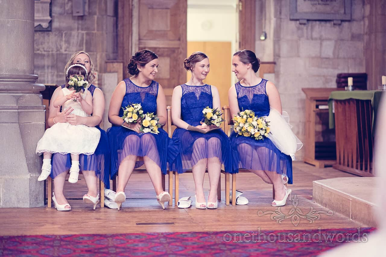 Bridesmaids in blue dresses with flowergirl