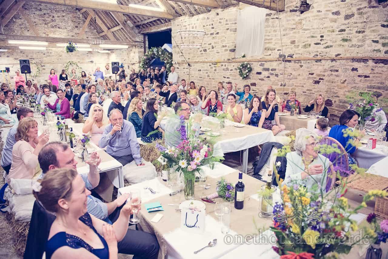 Barn wedding in Dorset guests toast speeches