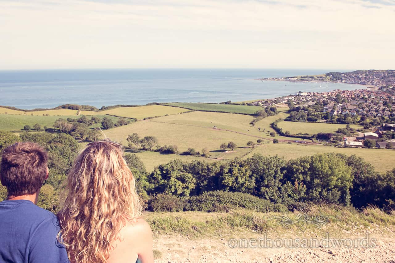 Engagment photographs looking over swanage bay