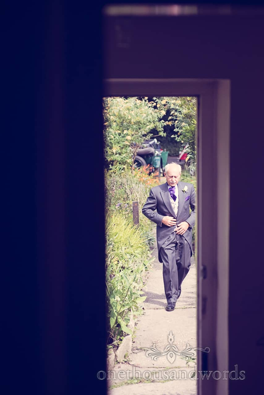 Father of Bride Arrives in Wedding Suit