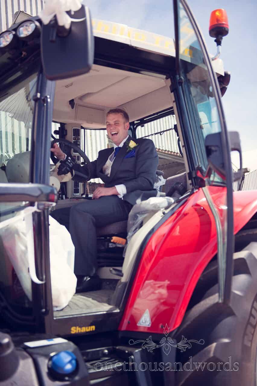 groom in Dorset wedding tractor