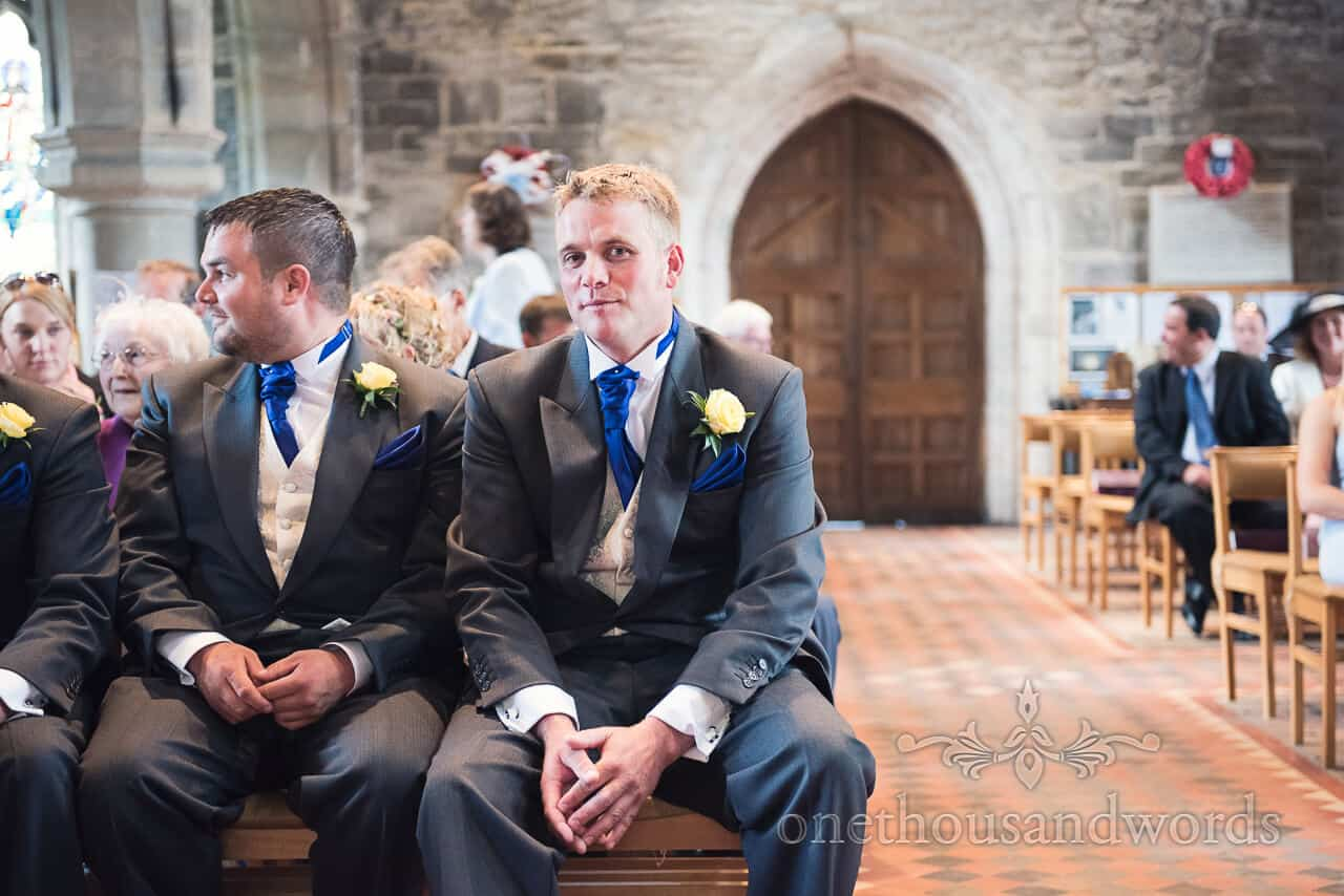 Groom waiting for bride in at church wedding