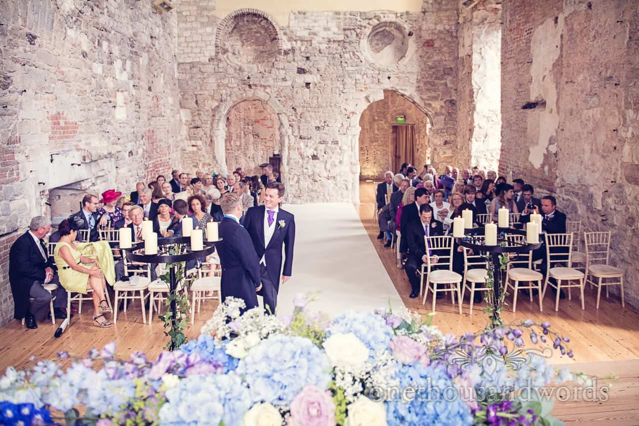Groom waits at Lulworth Castle wedding ceremony