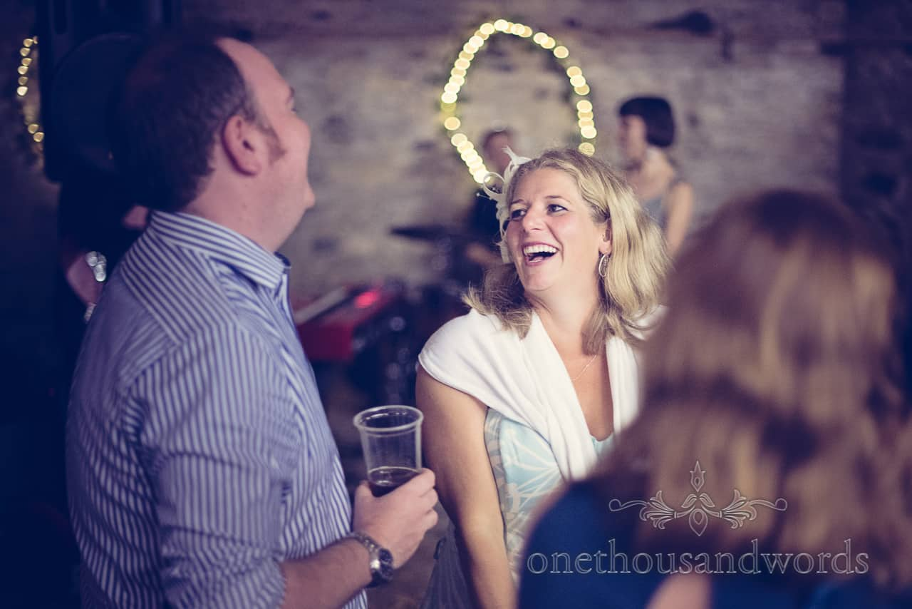 Guest laughing at Rempstone Barn wedding in Dorset