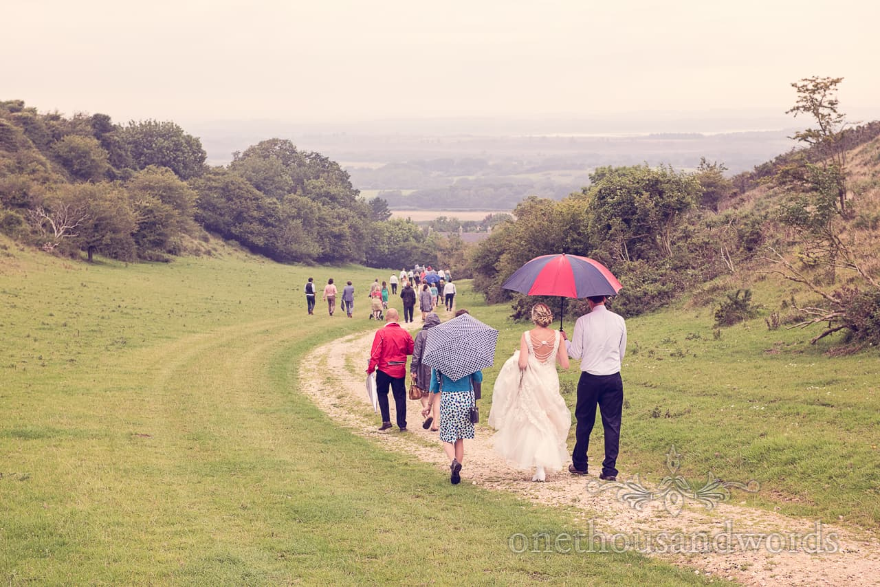 Wedding Guests Walk in the Rain in Dorset Countryside