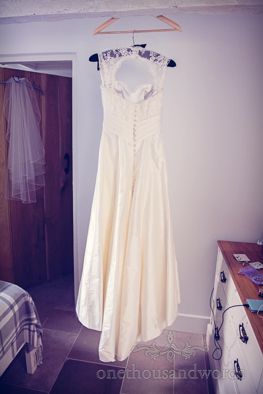 Ivory wedding dress photograph on wedding morning