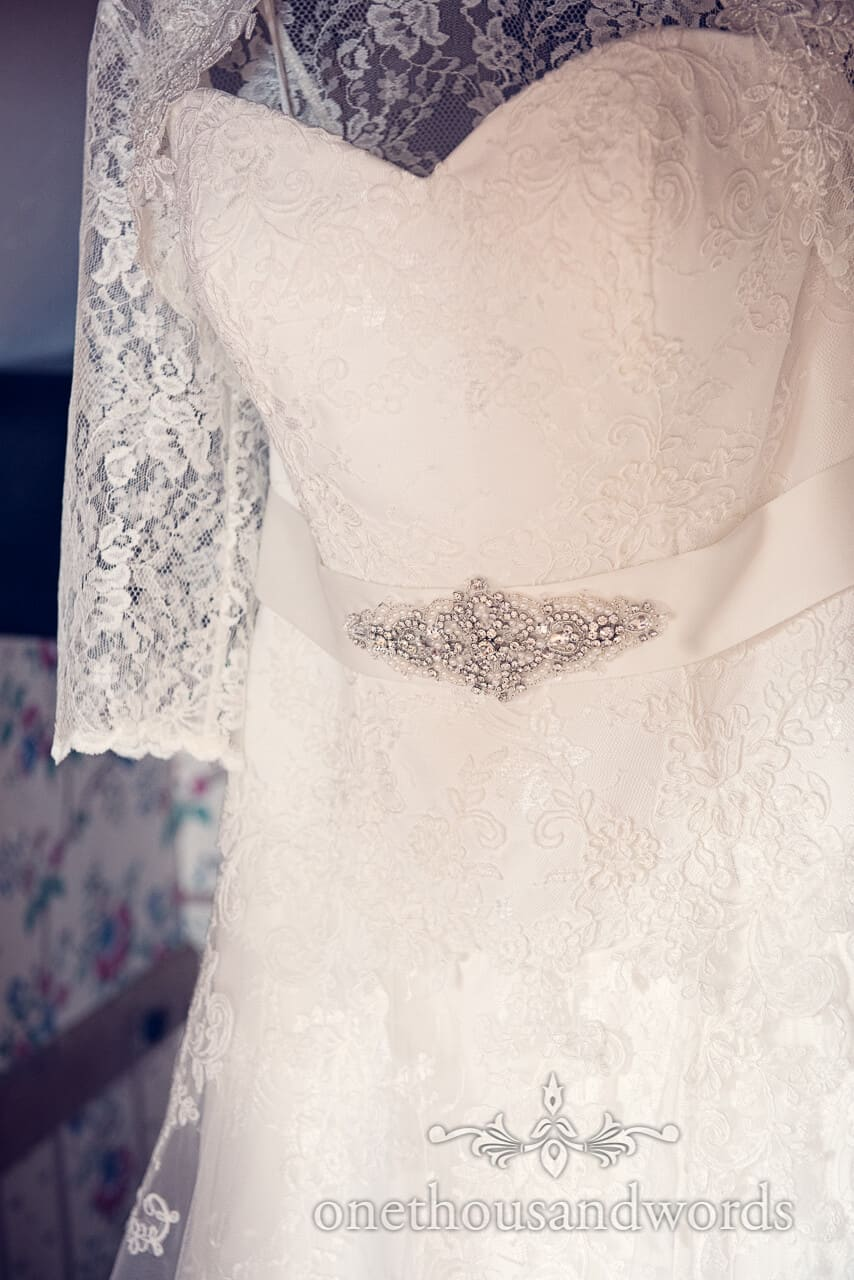 Lace and diamonte wedding dress detail photograph