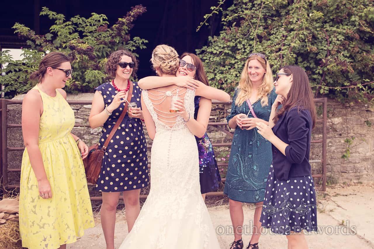 Ladies Hug Bride at Countryside Wedding in Dorset