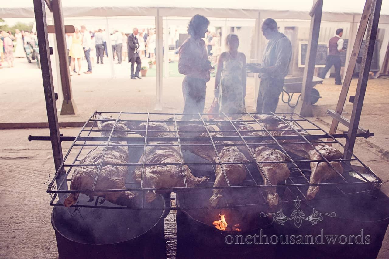 Lamb BBQ Over Barrels at wedding in Dorset