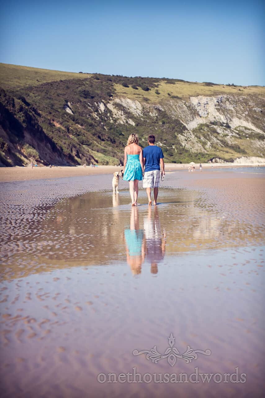 swanage beach engagement photographs reflection