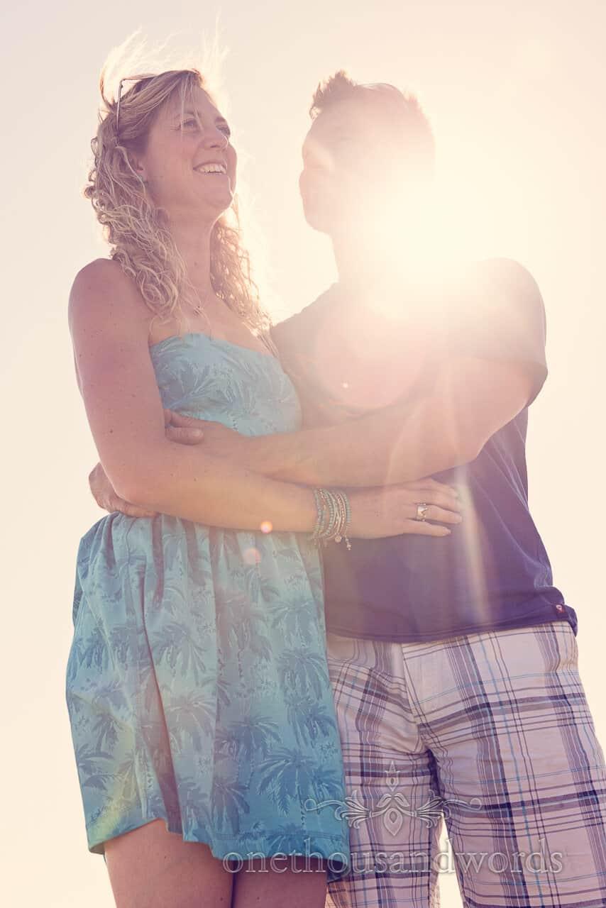 swanage beach engagement sunburst portrait