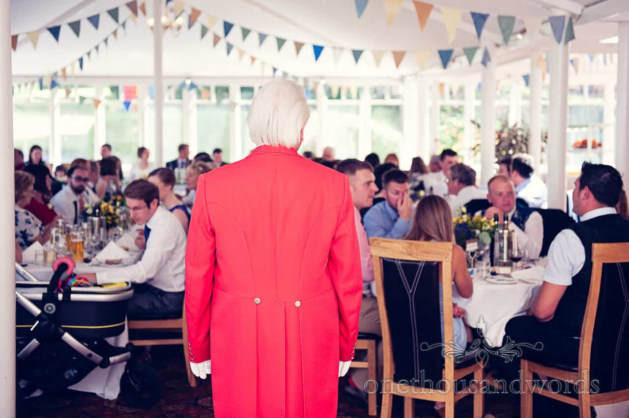 Toastmaster in red jacket at Purbeck House Hotel Wedding