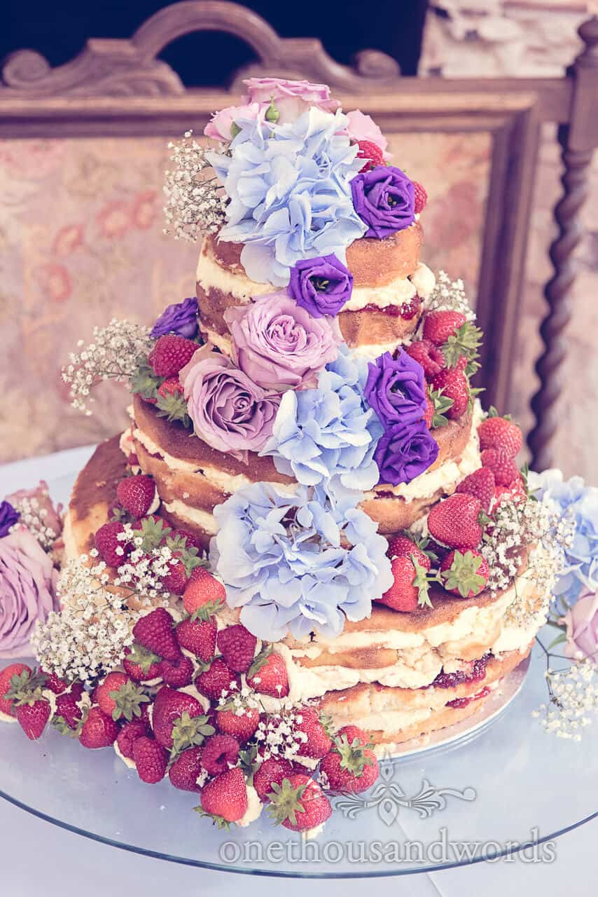 Victoria sponge wedding cake with flowers and fruit