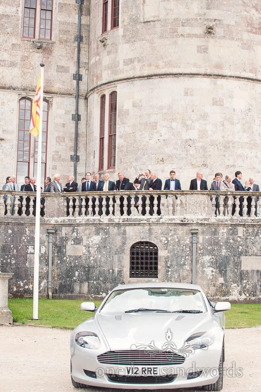 Wedding car at Lulworth Castle wedding with male guests