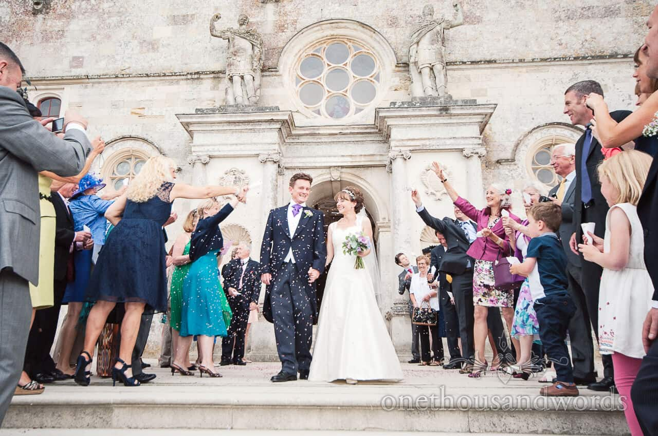 Wedding confetti at Lulworth Castle Wedding Photographers
