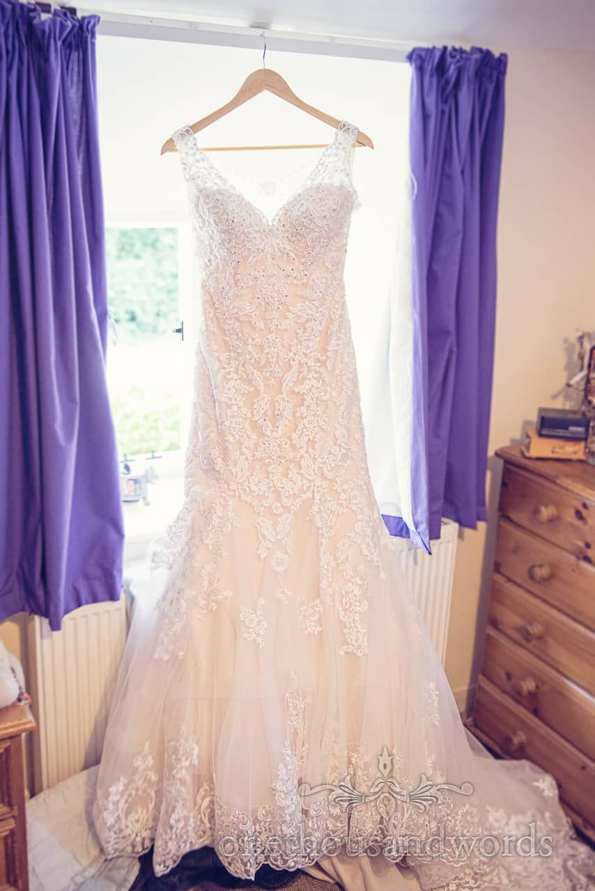 Detailed wedding dress hanging for wedding in Dorset