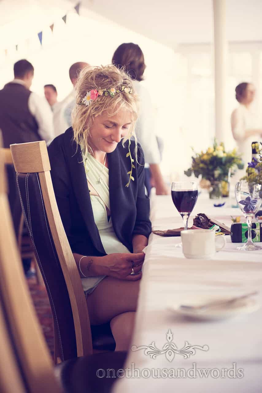 Wedding guest with floral head piece at Purbeck House Hotel