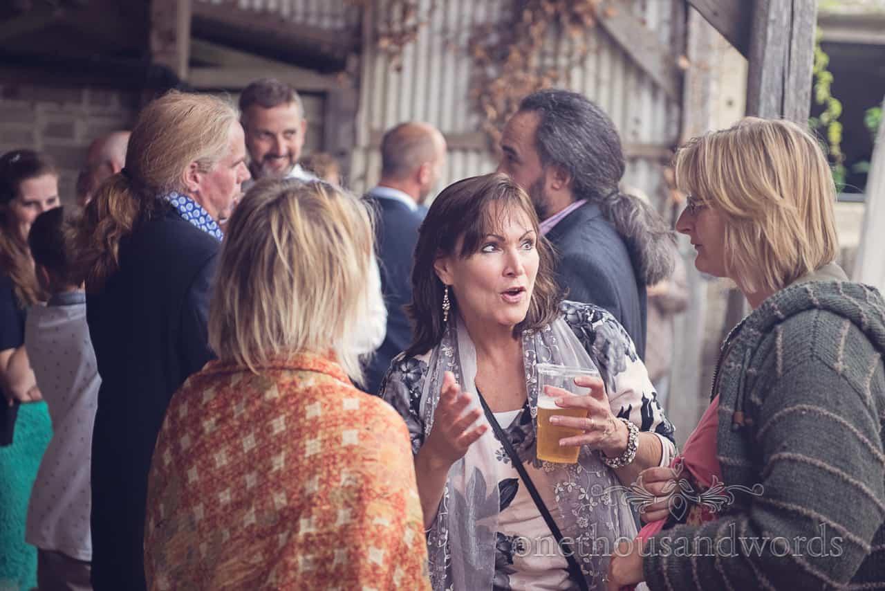 Wedding Guests Chatting at Barn wedding in Dorset