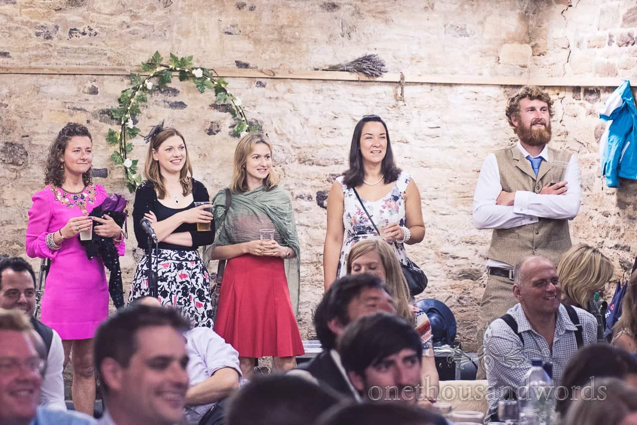 Wedding guests listen to wedding speeches