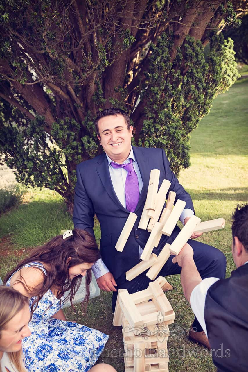 Wedding guests playing giant Jenga at Swanage wedding