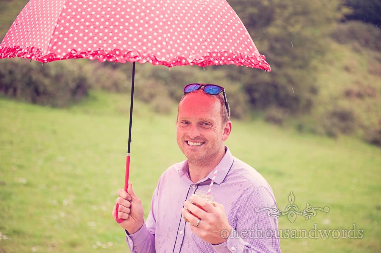 Wedding in Dorset Guest With Polka Dot Umbrella