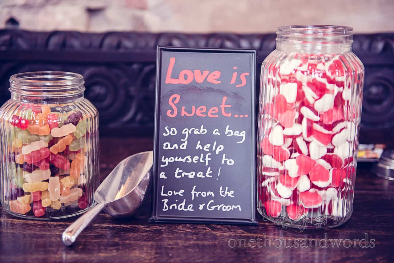 wedding sweet jars and sign at Lulworth