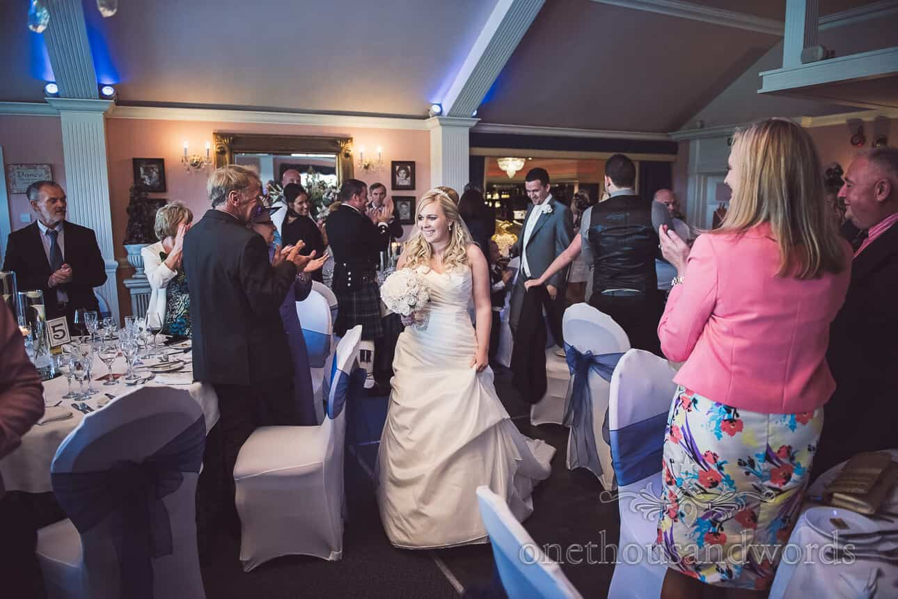 Bride & Groom enter Dudsbury Golf Club Wedding