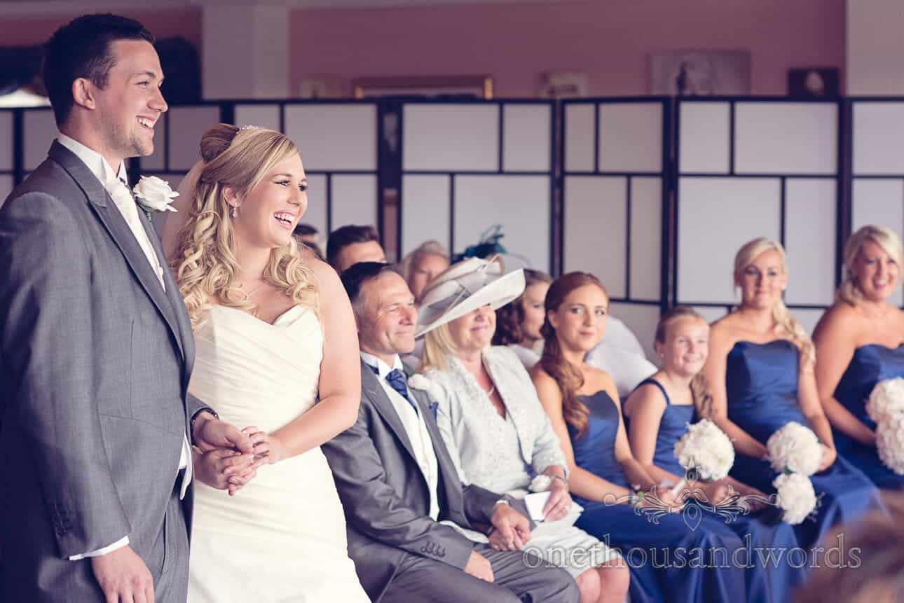 Bride and groom laugh at wedding
