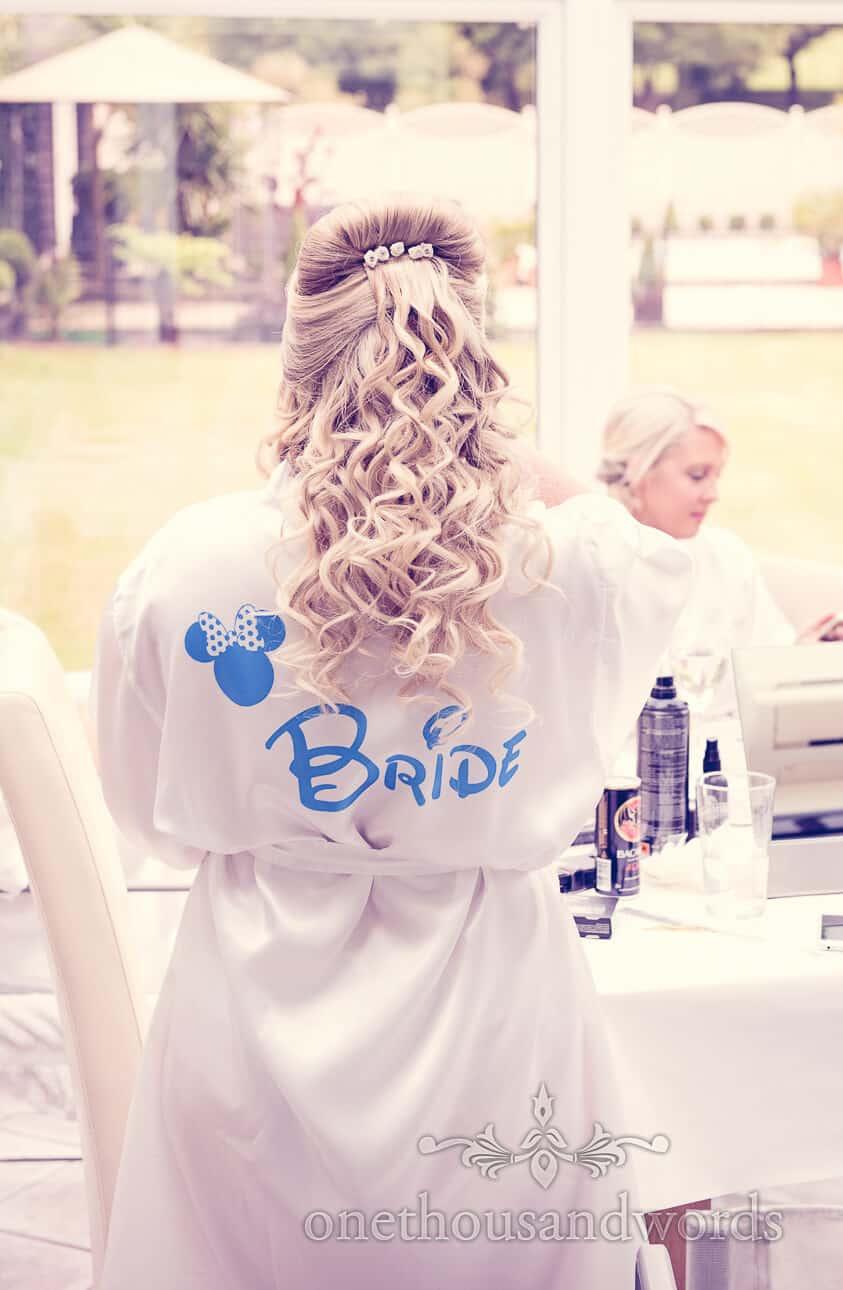 Bride in Disney themed robe on wedding morning