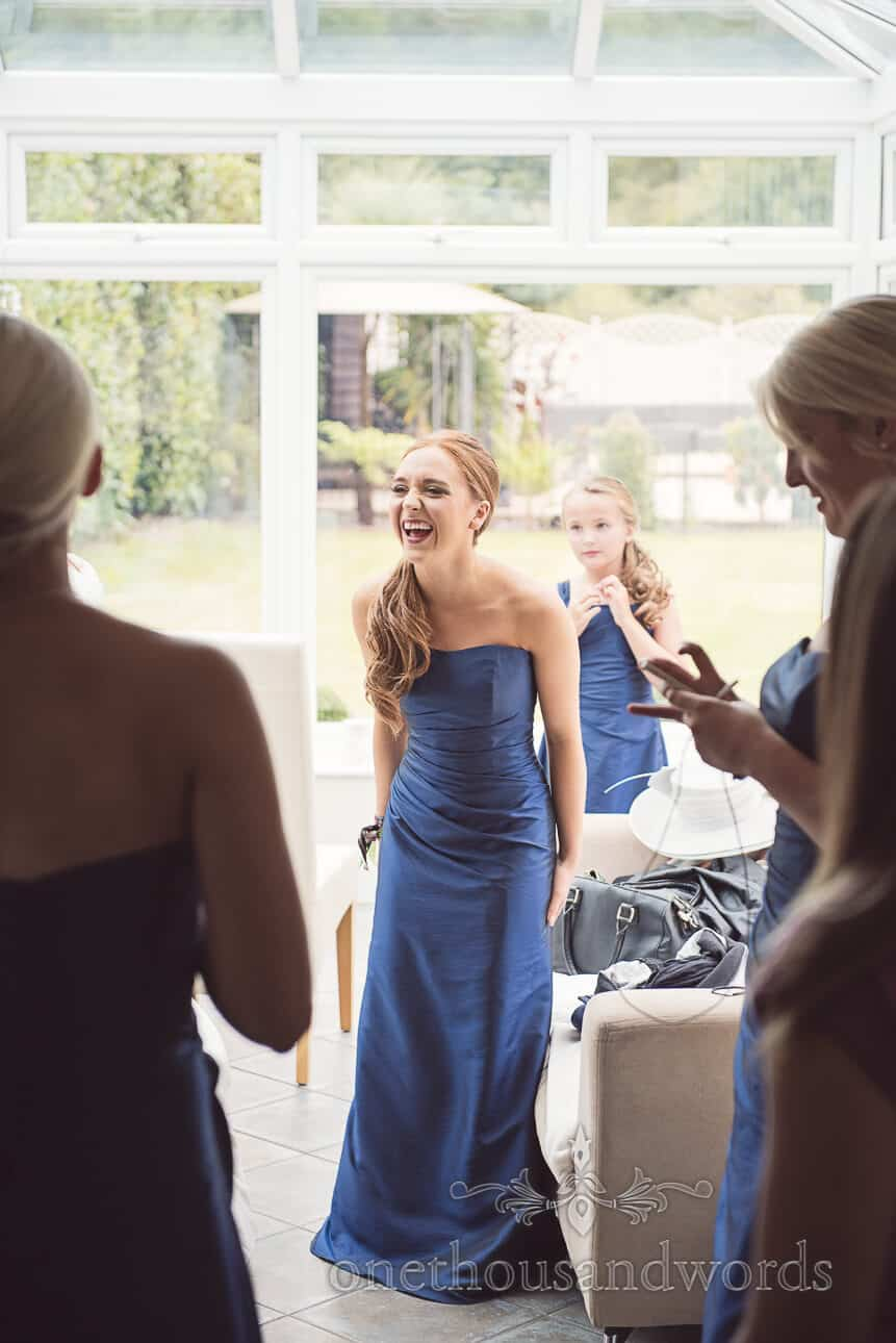 Bridesmaid in Blue Dress laughs on wedding morning