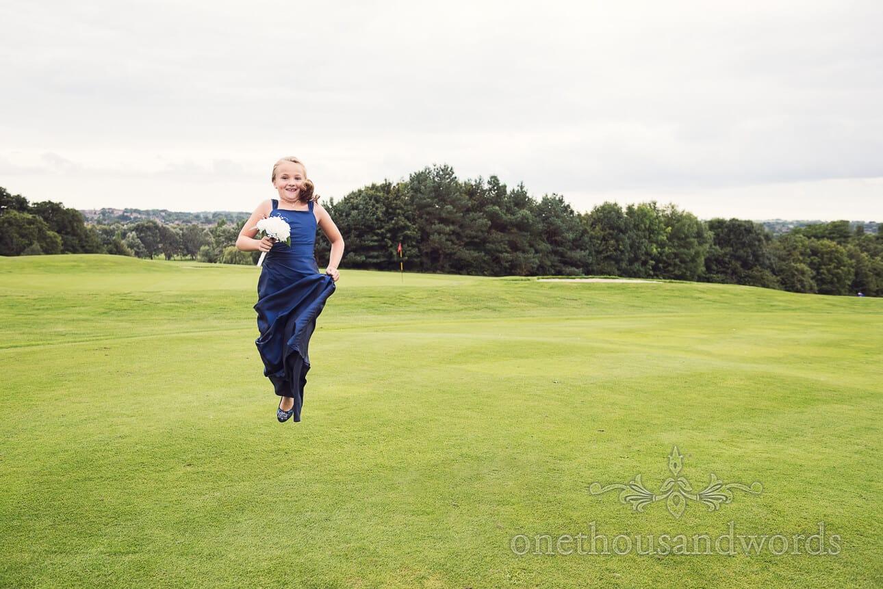 Bridesmaid in mid air at Dudsbury Golf Club Wedding reception