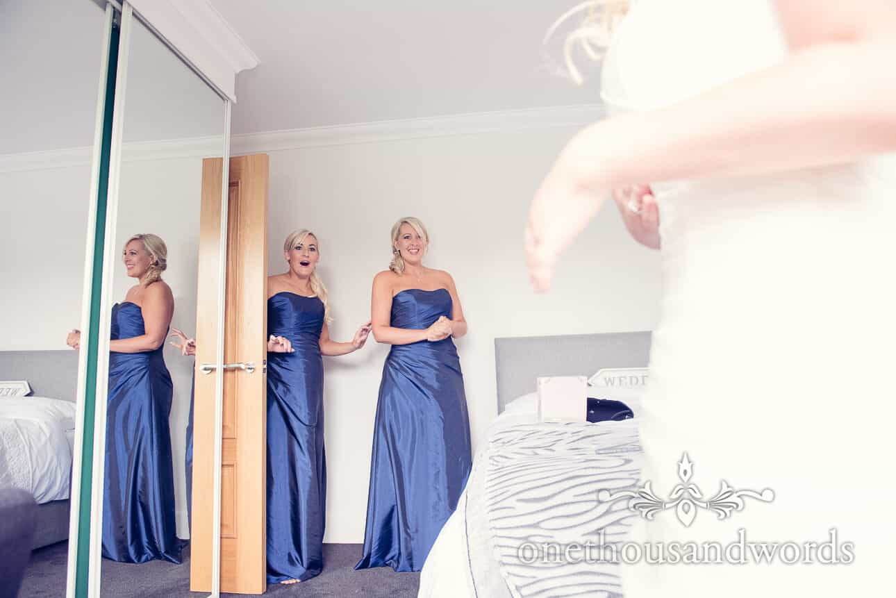 Bridesmaids react to bride on wedding morning